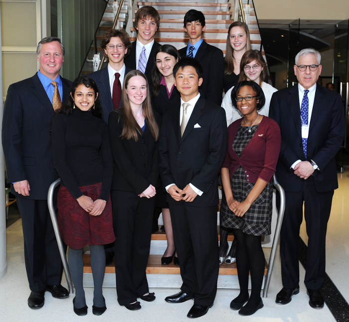 Front row from left: Junior Achievement President & CEO Ed Grenier, Maya I. Krishnan, Caroline B. Sherrard, first place winner Scott S. Yu, Mica L. Moore, and competition sponsor David M. Rubenstein. Middle row: Steven J. Goldberg, Jane E. Kessner, and Madeline M. Alpert. Back row: Luke M. Smith, Wilbur E. Shirley, and Katrina L. Hauprich.