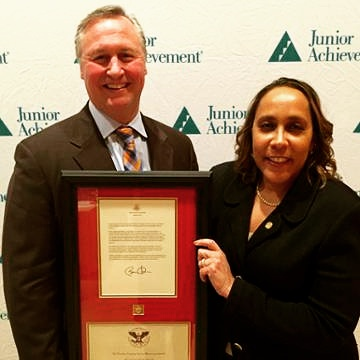 Ed Grenier, President and CEO of Junior Achievement of Greater Washington presents the U.S. President's Volunteer Service Award to Patty Brooks-Nobles, Senior Vice President and Regional Executive of Bank of America.