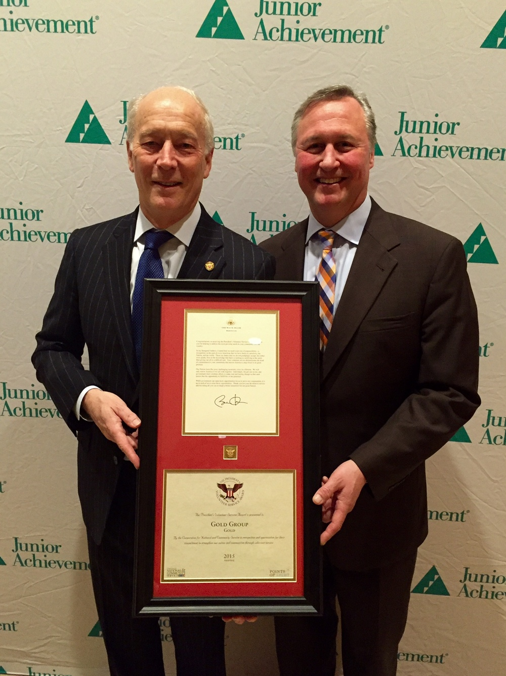Ed Grenier, President and CEO of Junior Achievement of Greater Washington presents the U.S. President's Volunteer Service Award to  Richard Woods, Senior Vice President of Corporate Affairs at Capital One.