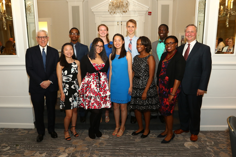 Back row from left: Competition sponsor David M. Rubenstein, Anene Uwanamodo, Marie Hatch, Zachary Stevenson, Seyi Anifowose (standing in for Ifedamola Anifowose) and JA President & CEO Ed Grenier. Front row from left: Renee Beck, Natalie Pargas, grand prize winner Xiu Chen, Emma Reese, and Ayibatari Owei. Not pictured: David Fischer.