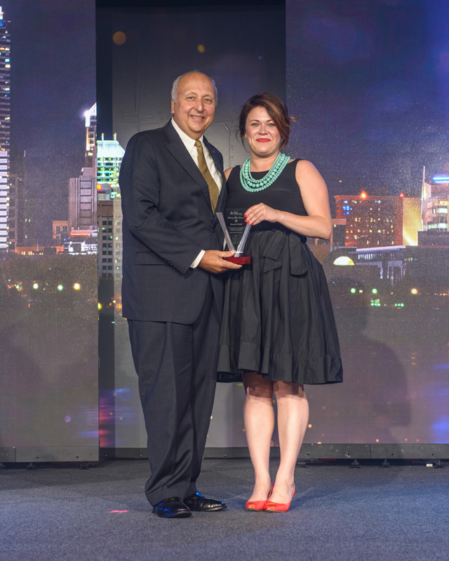 Jack Kosakowski, President and CEO of Junior Achievement USA, presenting Sarah Dohl, Vice President of Communications for Junior Achievement of Greater Washington with the Rising Star Award.
