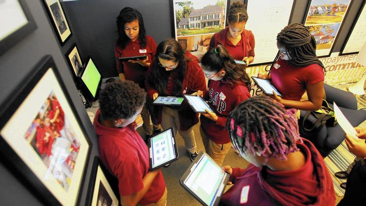 October 13, 2016: Dwight Eisenhower Middle School eighth grade students participated in an experimental learning program by working on tablet computers and learning about the importance of income; saving, investing and risk management; debit and credit; and budget. (Daniel Kucin Jr. / Baltimore Sun Media Group)