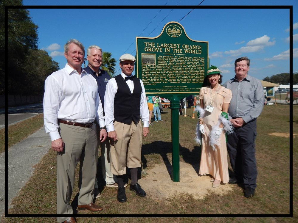 -  January 21, 2017, (L-R) Ken Ward, Kim Leinbach, Tim Lancaster, Beth Bosserman Curts, a mini-Temple Orange Grove was planted at Greco Middle School along the fence that borders the track. A dedication ceremony was held with installation of a historic marker sponsored by Ken Ward & Family, the Temple Terrace Preservation Society and Temple Terrace Farm2School.