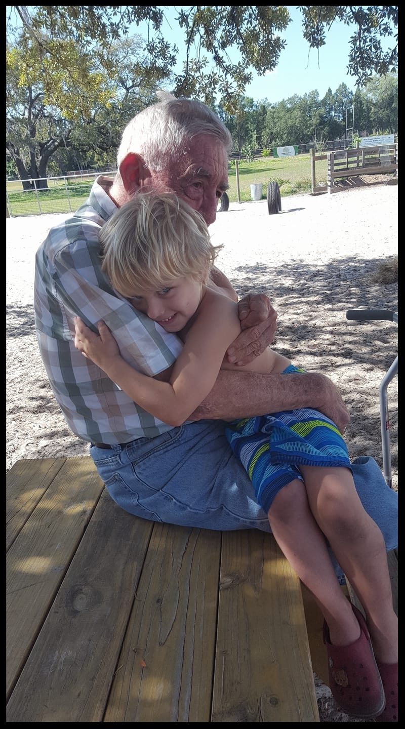Julian gessman gets some love from his Grandpa at the Greco Farm.