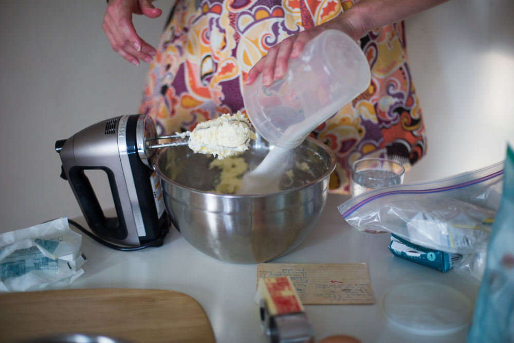 2. Add 1 lb of granulated sugar to the butter mixture.