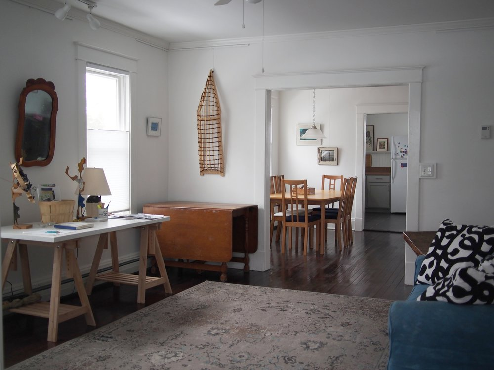 The gallery and the dining room in the Aitken residency space.
