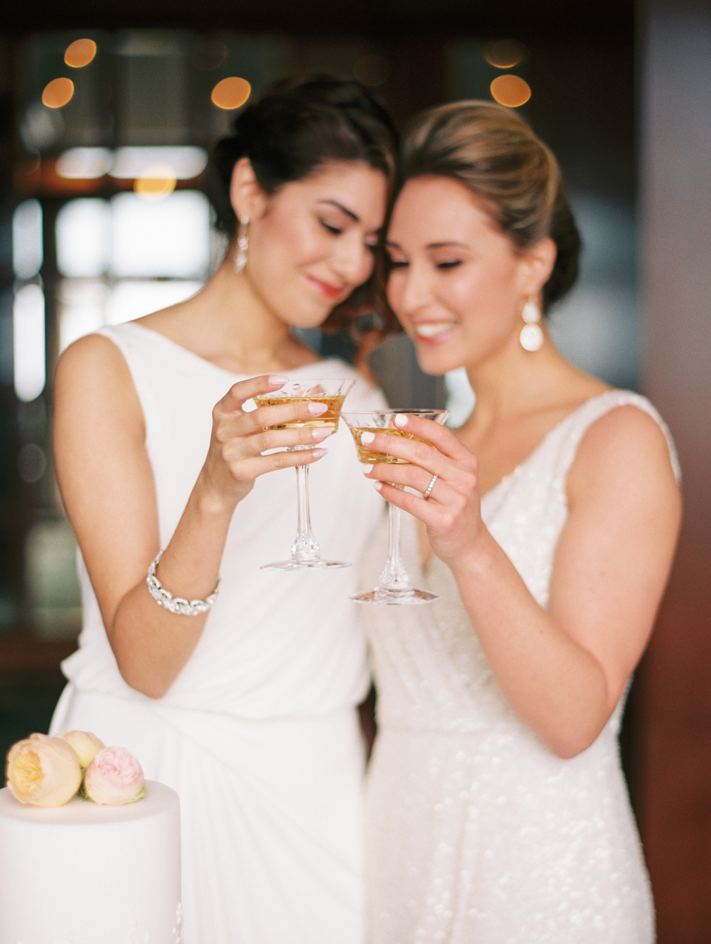 Two Brides Toast Champagne