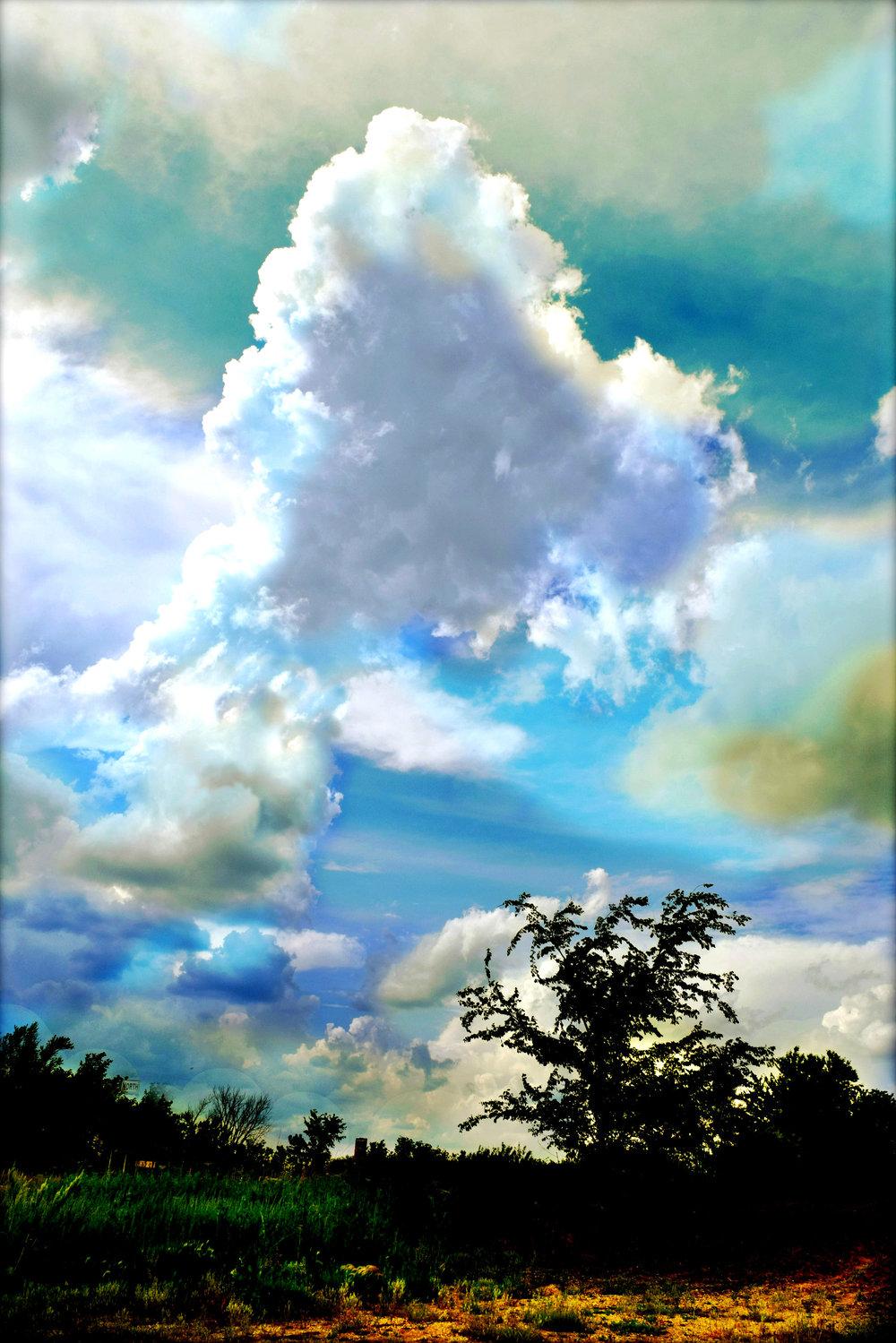 Clouds near Kalona Maggie Burns 2016    11x17 $60, 13x19 $80, 8x11 $50