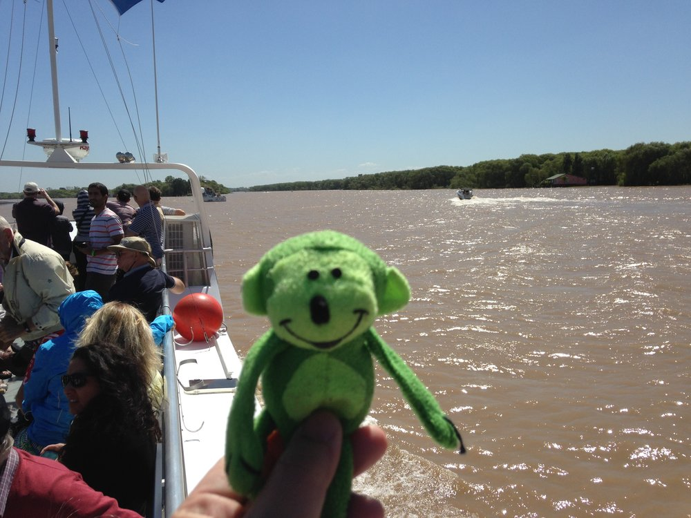 Mr. Greenspots on a boat, he's my travel buddy for my  son's benefit
