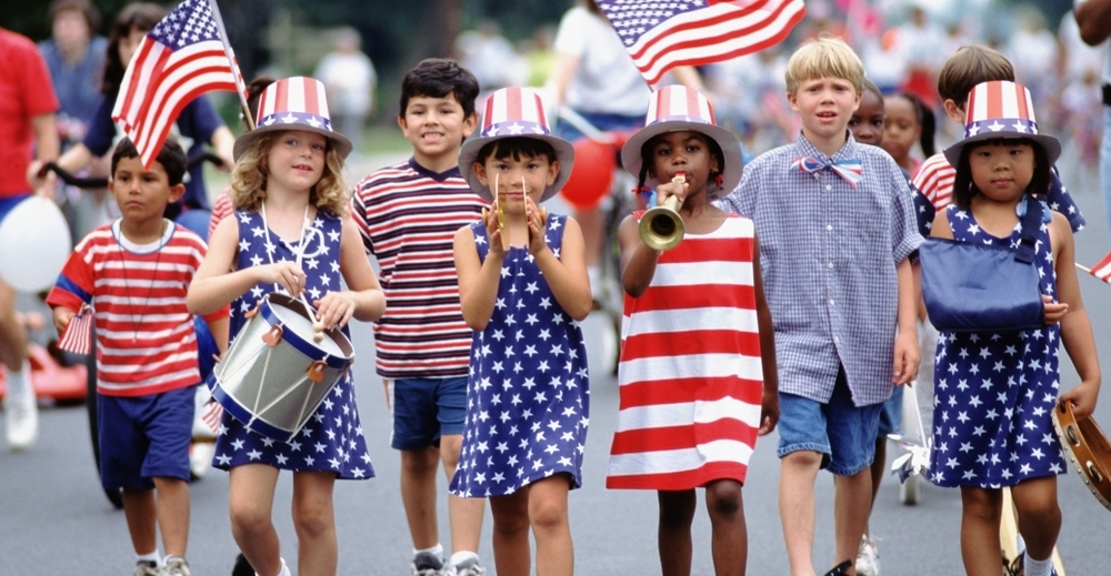 Children partake in Fourth of July celebrations. Photo by History.com.