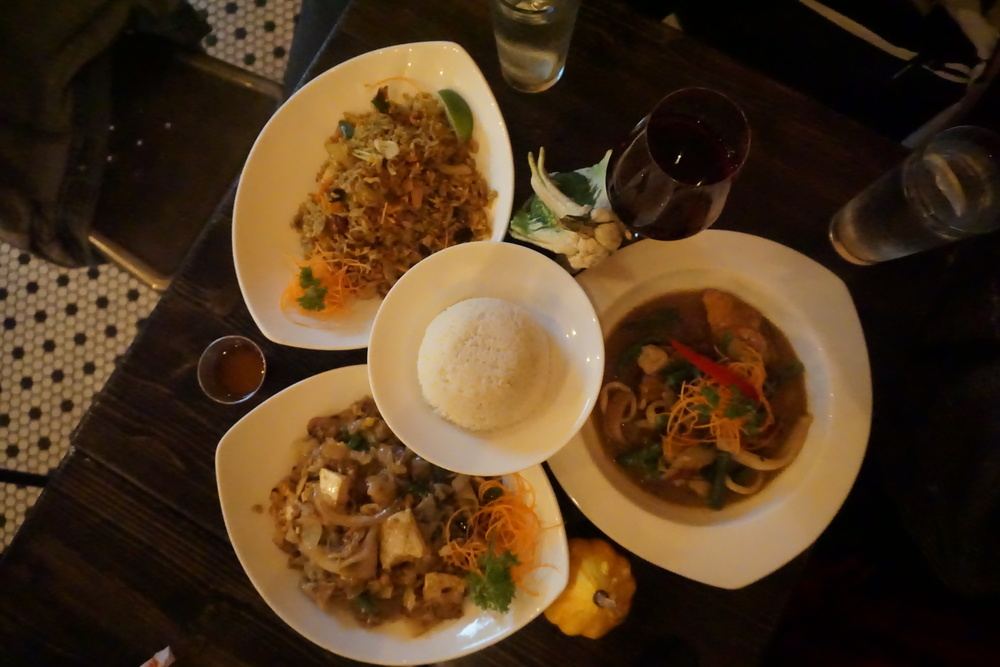 The seafood, kee mao, and fried rice dishes we ordered, along with our drinks.
