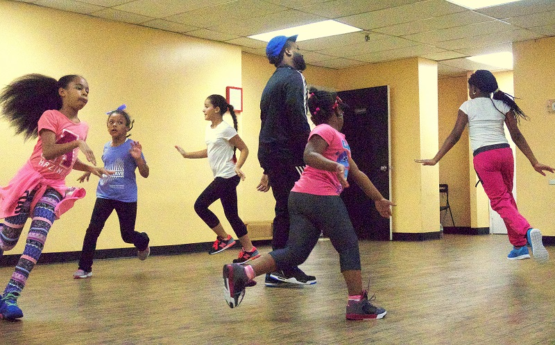 Jerzey teaching a Kids Hip Hop class at Lotus Creations