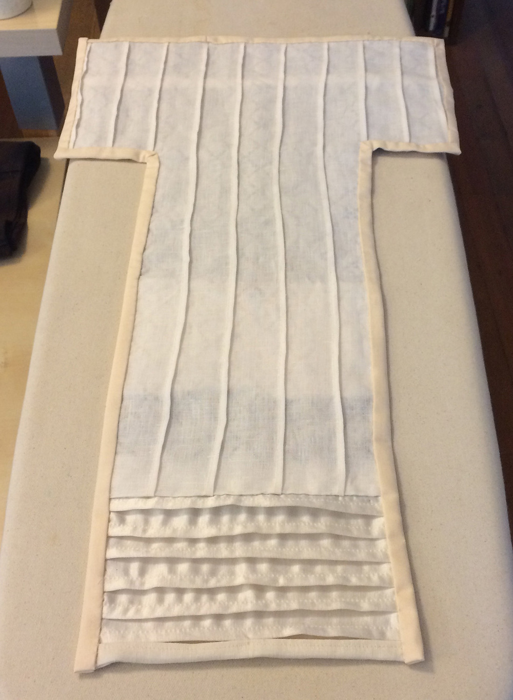The back of a black and white composition of pleats and quilted squares.