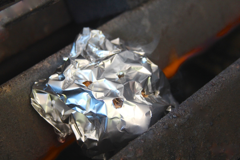 Create a makeshift smokerbox with foil