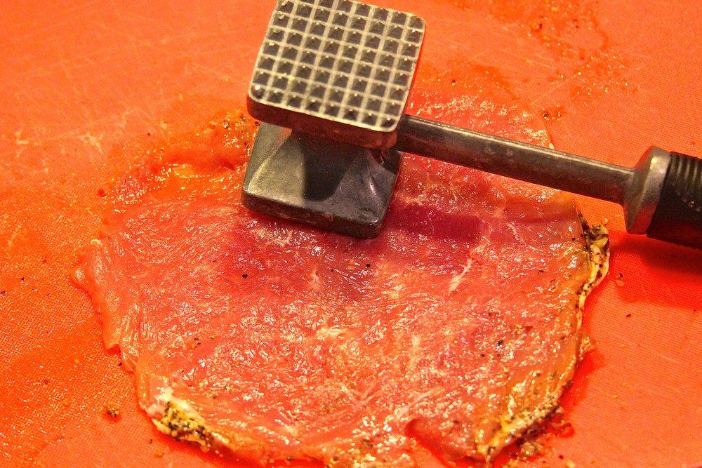 Flatten the butterflied pork tenderloin section
