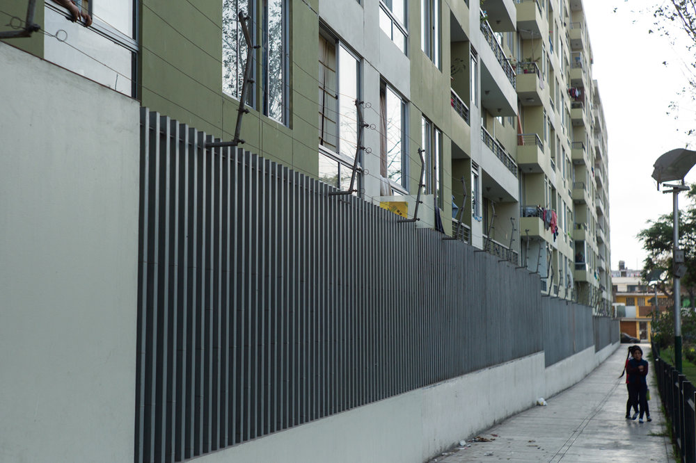 The perimeter of the building is heavily guarded by a tall wall, an electric wire, cameras and a private guard who walks the perimeter of the building occasionally.