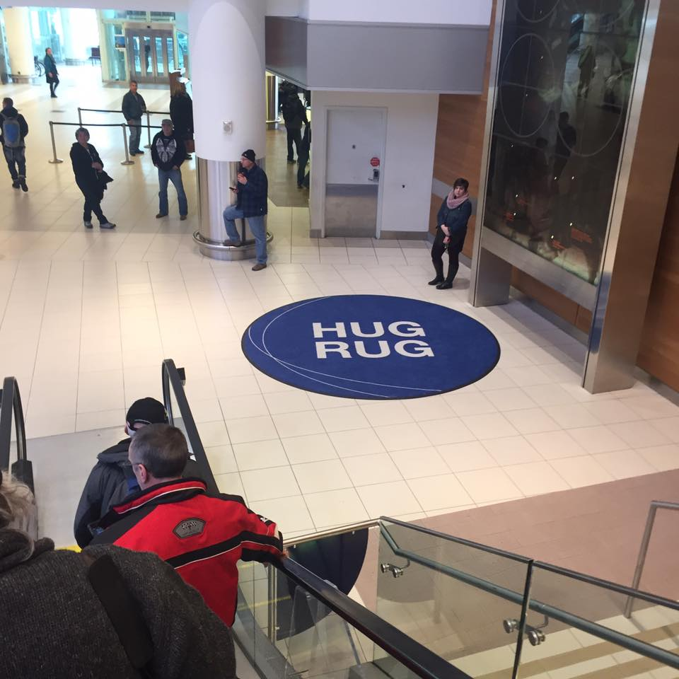The Hug Rug in Winnipeg Airport, often used to welcome new families to Canada.