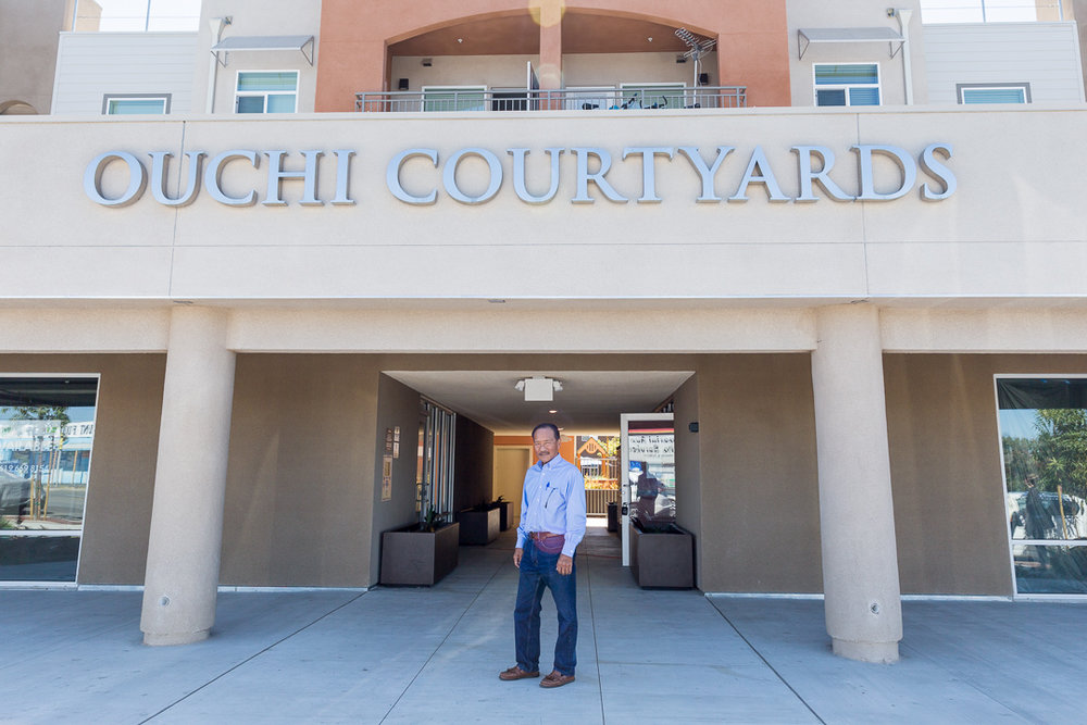 Robert Ito in front of Ouchi Courtyards (Photo: Colin Leibold)