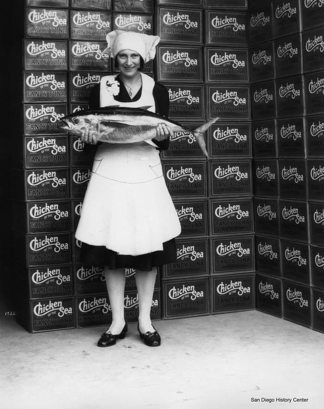 Van Camp Seafood Cannery employee holding a tuna, 1931. Image: San Diego History Center