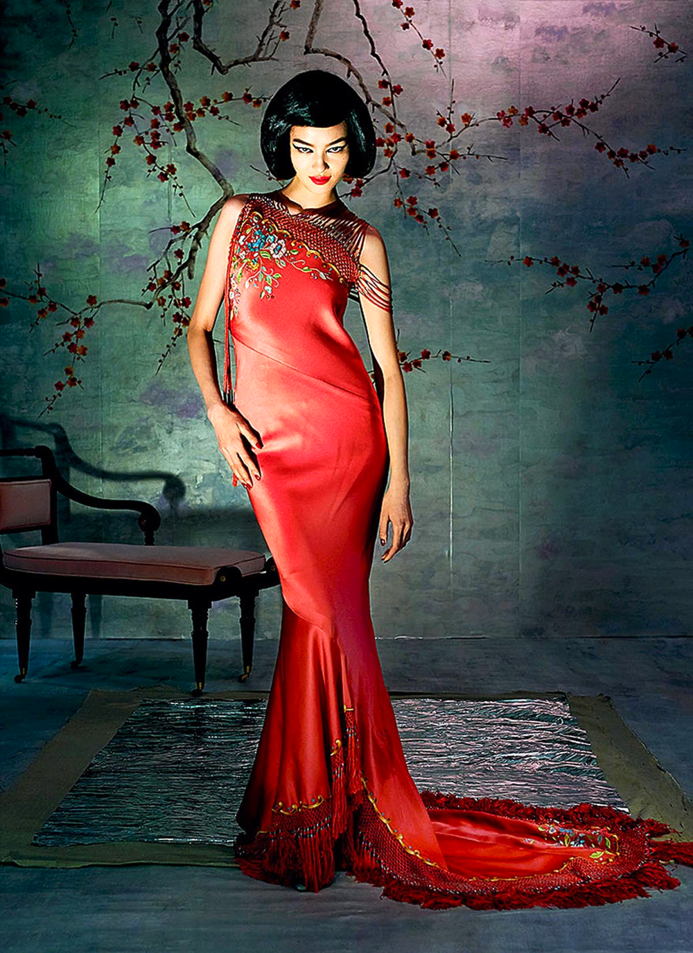 Scarlet has so many associations: firecrackers in their bright wrappers; the lucky red-paper trinkets of the Chinese New Year. John Galliano summoned to mind these references for Christian Dior Haute Couture in Spring 1997 with this silk fringed dress with a delicate tracing of flowers from the shoulder.