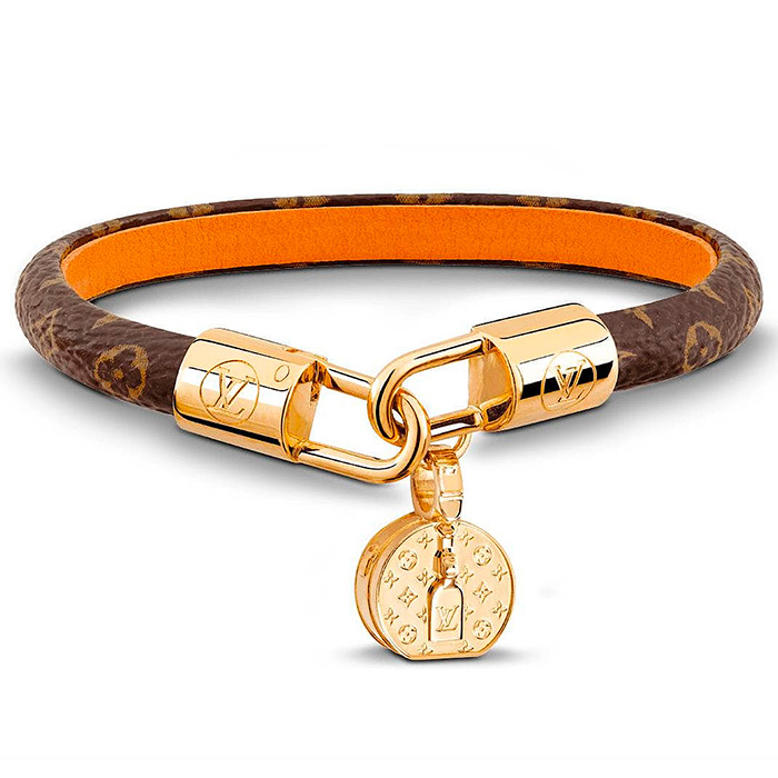 LV Tribute Bracelet $345.00 with a charm shaped like a hat box