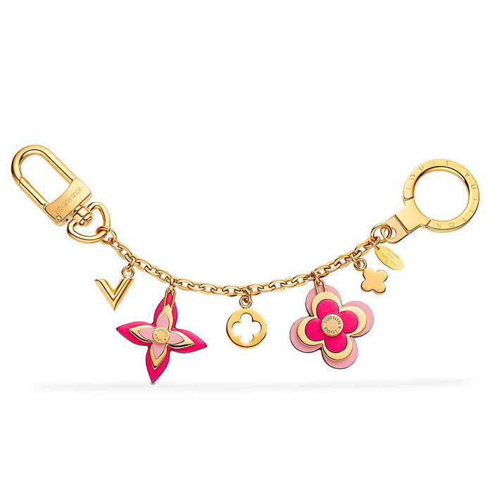 Blooming Flowers Chain Bag Charm and Key Holder $515.00 embellished with tiny studs, small gold Vs and flower charms