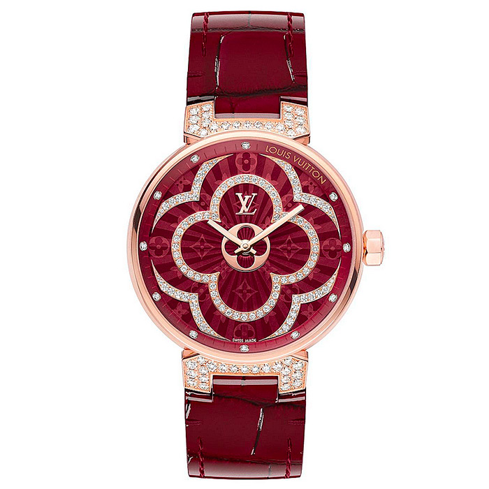TAMBOUR MOON DIVINE 35 $30,195.00 White mother-of-pearl dial with Monogram flowers enhanced by 108 diamonds
