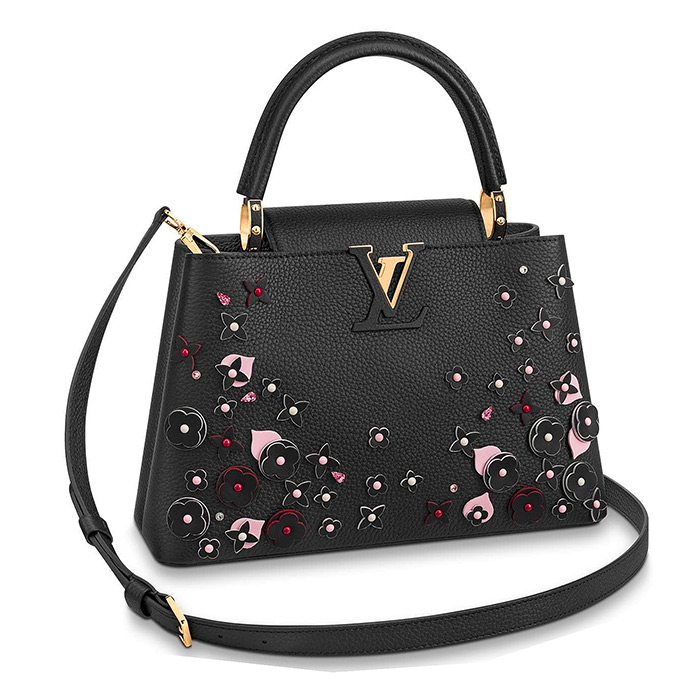 CAPUCINES PM in Black $5,700.00 L 12.2 x H 7.7 x W 4.3 inches, Black Taurillon leather adorned with flowers as part of the LV Blooming edition