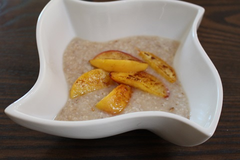 Barley, coconut milk, coconut sugar and peaches in coconut oil breakfast.