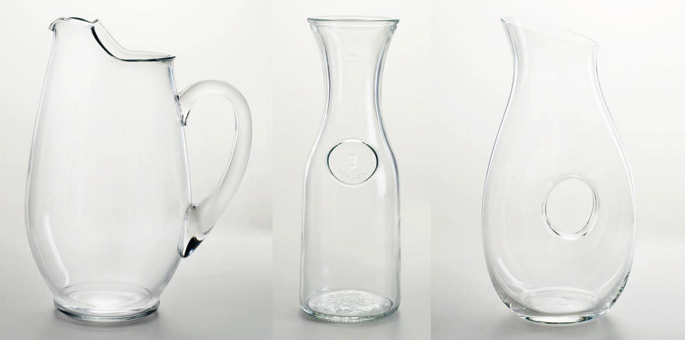 All three of these beautiful glass pitchers (technically, the middle one is called a carafe) are under $15 from World Market! ( Mario Pitcher , $12.99 |  Glass Carafe , $5 |  Clear Pitcher with Hole Design , $14.99)