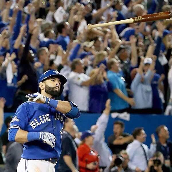 Jose Bautista and the awesomely famous bat flip. Photograph: Tom Szczerbowski/Getty Images