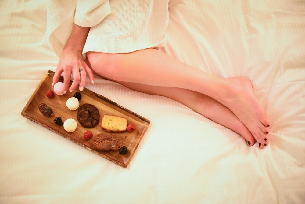 Indulging in a few treats while relaxing on the comfiest of beds at Sofitel Montreal. Photo by  Tobias Wang .