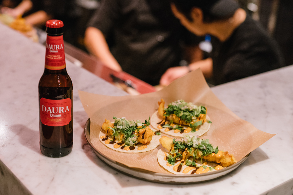 West Coast Rockfish Taco - wild BC snapper, corn batter, lettuce, tamarind balsamic sauce, chipotle mayo & tomatillo salsa