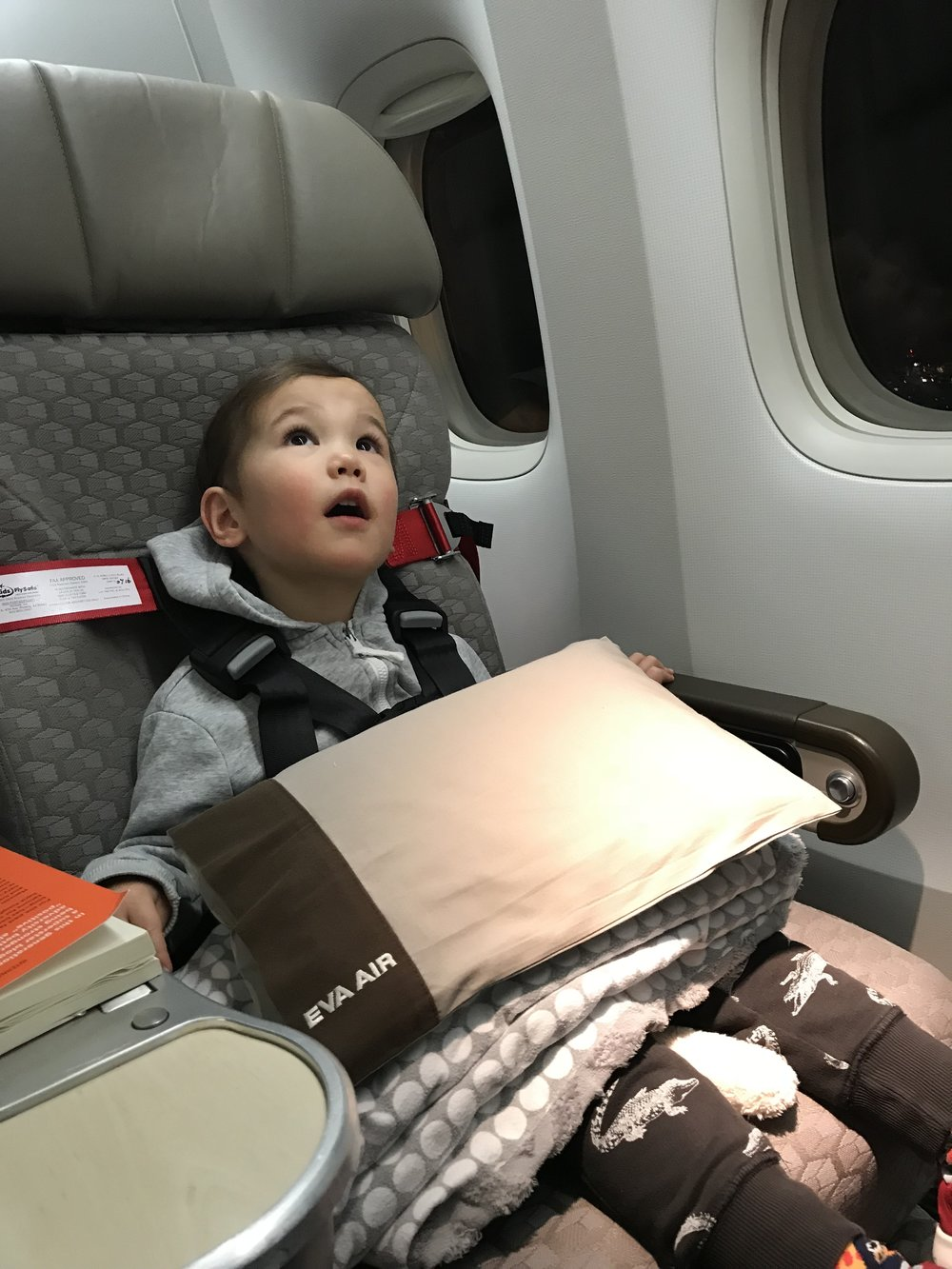 Our son all buckled in and ready for take-off on his first flight to Taipei. We loved the extra comfort of our Premium Economy seats on EVA Air.