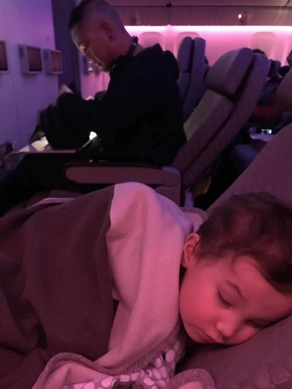 Settling-in and getting comfy on our EVA Air flight to Taipei. Bringing familiar items like a blankie, toys and books are a must for travel with the kiddos.