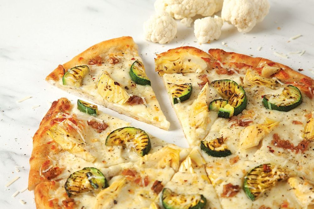 mmmmmmm.......Whether you're into sophisticated flavours like the Cauli Blanca here or just plain old pep and cheese, the Cauliflower Crust from Pizza Pizza is a great alternative that provides two servings of veggies in each medium crust!