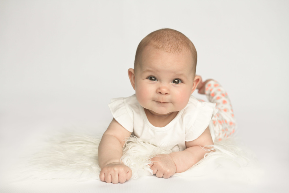Cambridge-children-photographer-studio-session-with-sheepskin