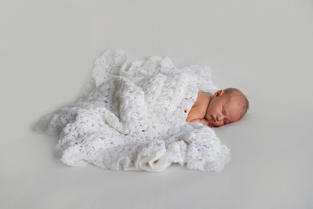 Newborn-photo-with-family-shawl.jpg