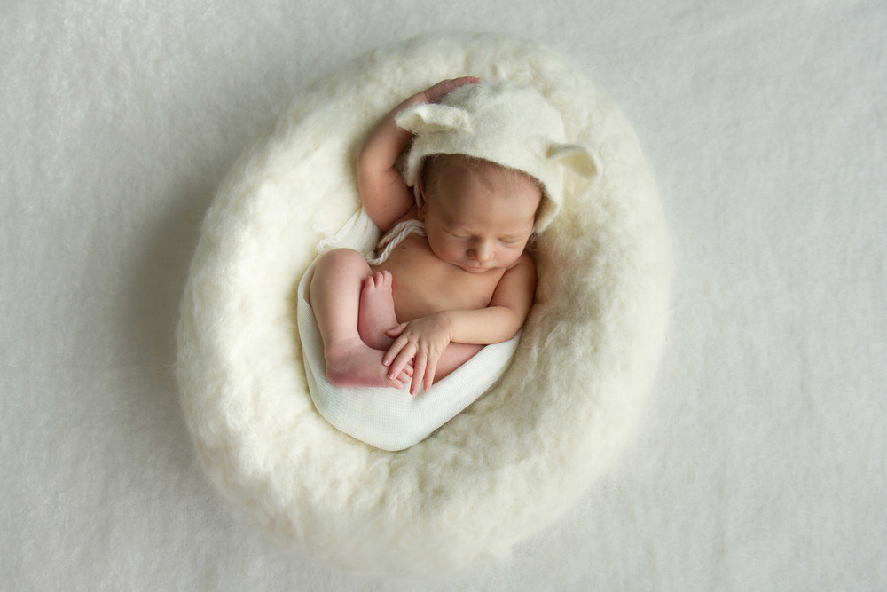 Hamilton-photographer-newborn-in-wool-nest-with-lamb-hat.jpg