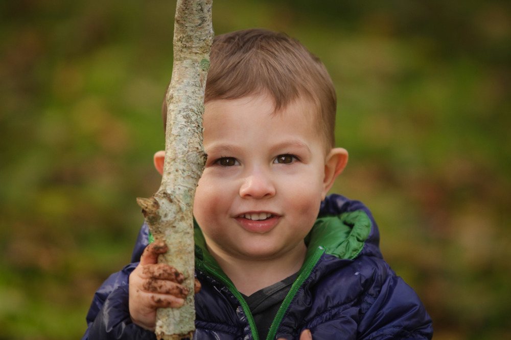 Hamilton-photographer-toddler-playing-with-stick.jpg