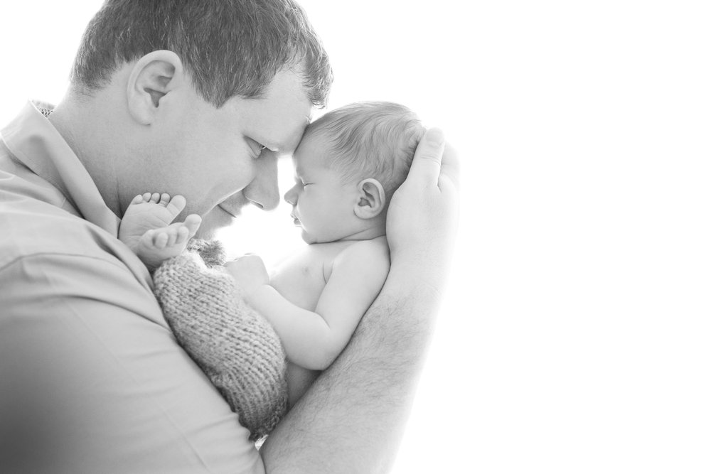 Baby-with-dad-newborn-photography.jpg