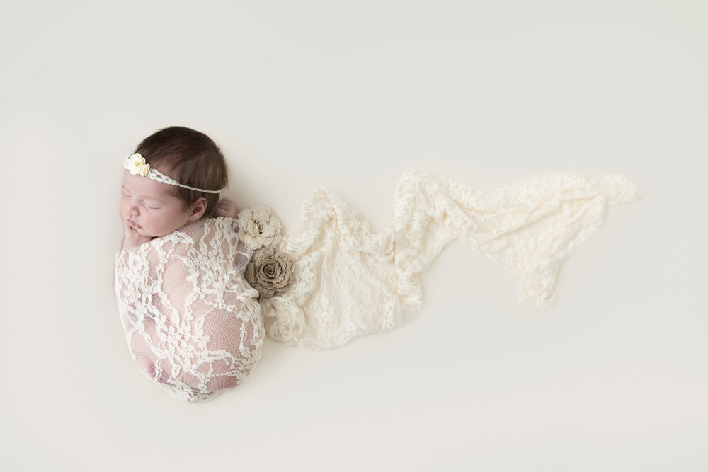 Lace-and-flowers-rustic-newborn-photo.jpg