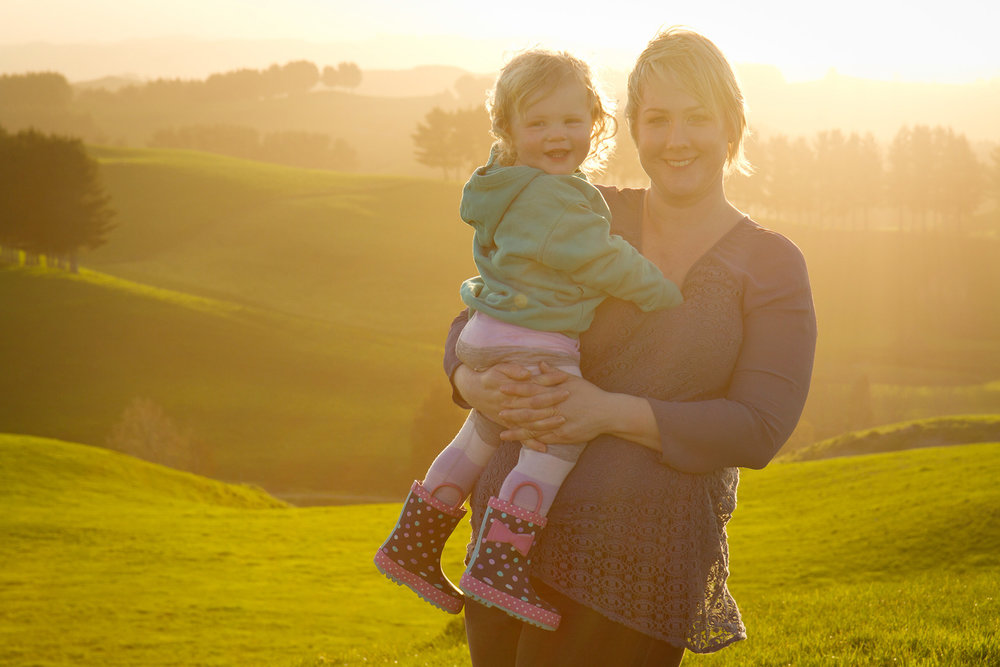 Waikato-family-photographer-cuddles-with-mum.jpg