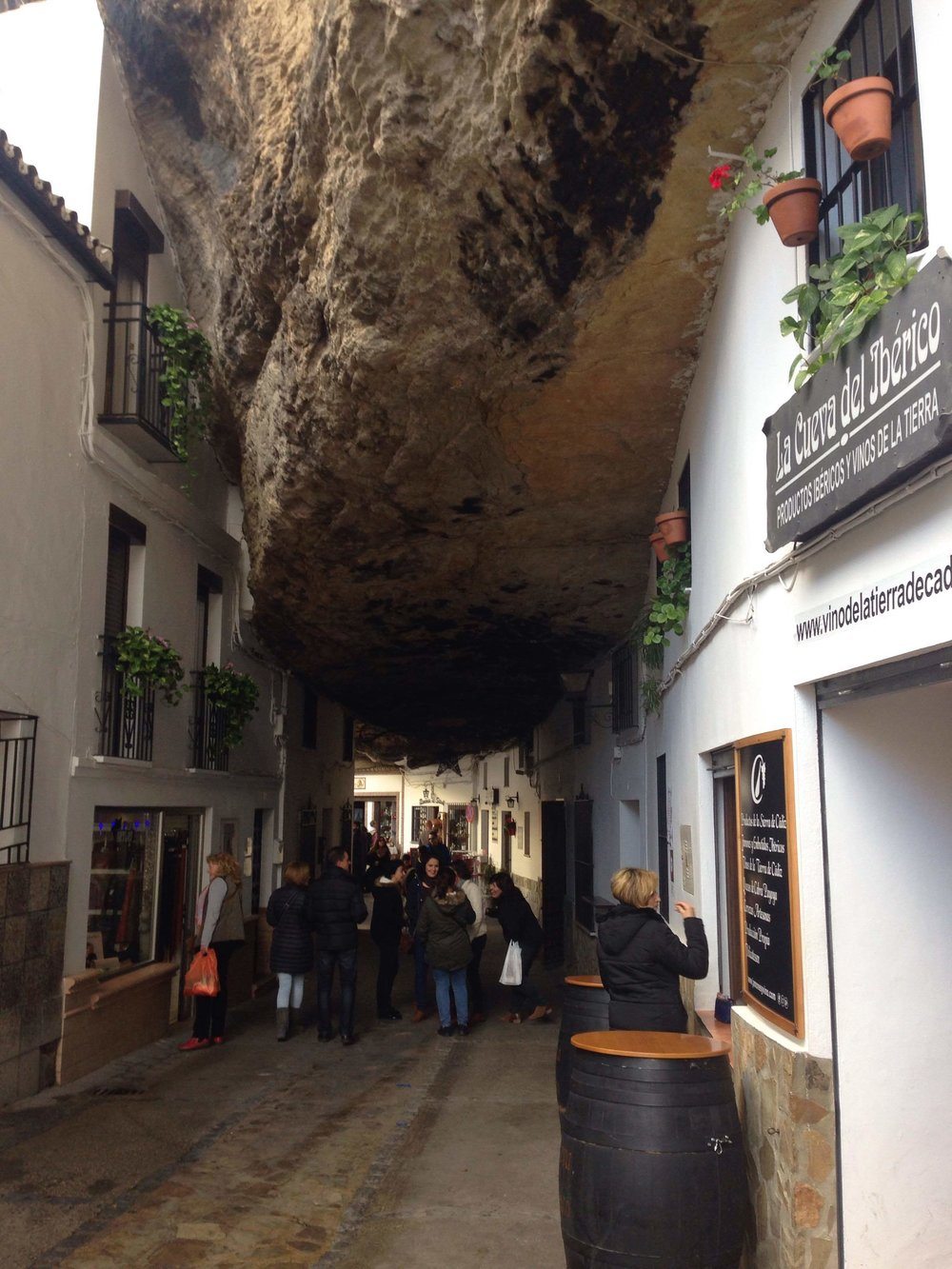 The Sombra, or shadowed side of Setenil, with a street that runs under the rock