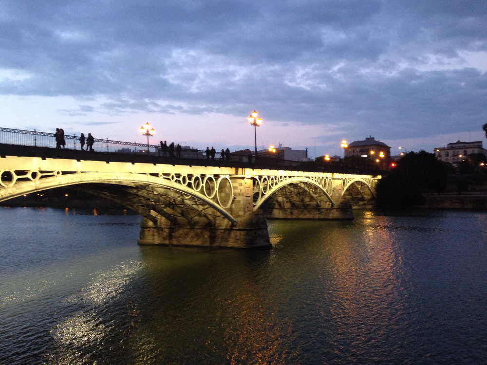 The Triana Bridge at dusk.