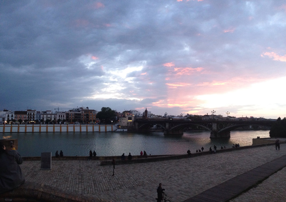 Sunset over Triana from the Sevilla side of the bridge
