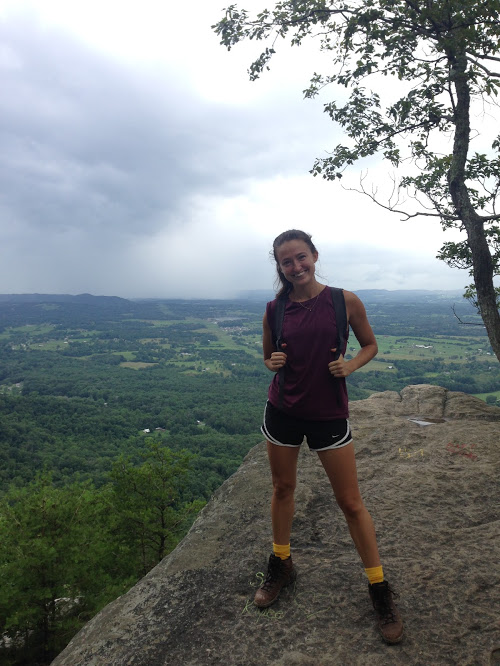 House Mountain hike I did with my sister. This is me posing with the storm that drenched us on our way down.