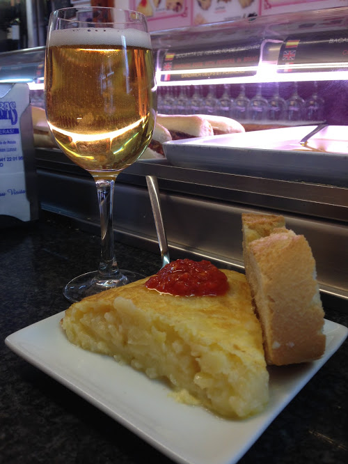 Spanish tortilla with spicy sauce. Spicy food in Spain.. our minds were blown!