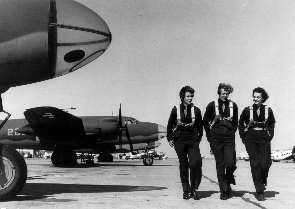 Three members of a group of Women Airforce Service Pilots on flight line, 1944 | USAF