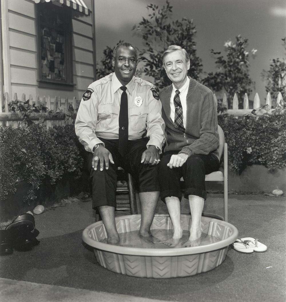 (Officer Clemmons and Mister Rogers, reprising their 1969 foot bath, during their final scene together in 1993 | The Fred Rogers Company)